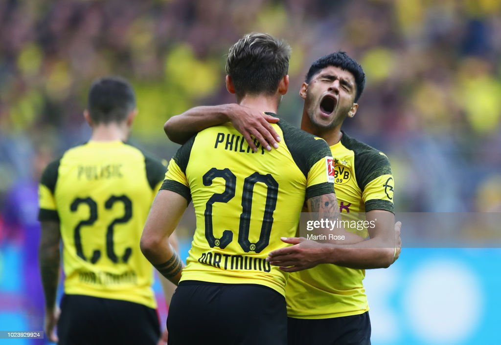 Mahmoud Dahoud of Borussia Dortmund (right) celebrates after scoring his team's first goal with Maximilian Philipp of Borussia Dortmund during the Bundesliga match between Borussia Dortmund and RB Leipzig at Signal Iduna Park on August 26, 2018 in Dortmund, Germany.