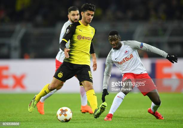 Mahmoud Dahoud of Borussia Dortmund is watched by Diadie Samassekou of Red Bull Salzburg during the UEFA Europa League Round of 16 match between...