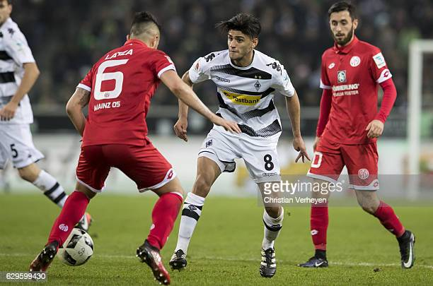 Mahmoud Dahoud of Borussia Moenchengladbach and Danny Latza of FSV Mainz 05 battle for the ball during the Bundesliga match between Borussia...
