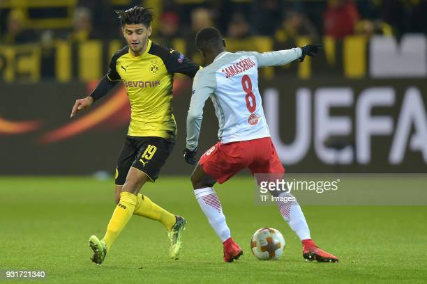 Mahmoud Dahoud of Dortmund and Diadie Samassekou of Salzburg battle for the ball during UEFA Europa League Round of 16 match between Borussia...