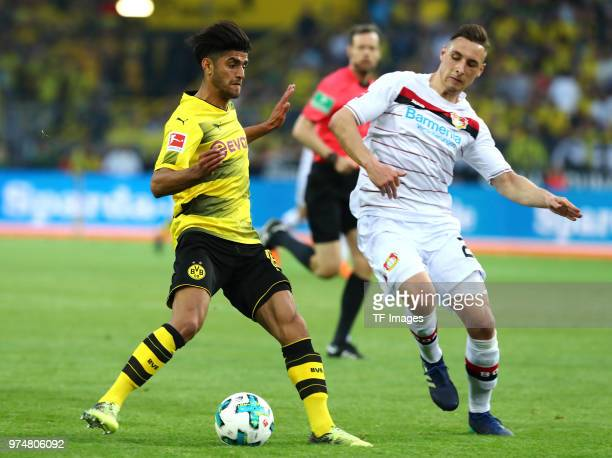 Mahmoud Dahoud of Dortmund and Dominik Kohr of Leverkusen battle for the ball during the Bundesliga match between Borussia Dortmund and Bayer 04...
