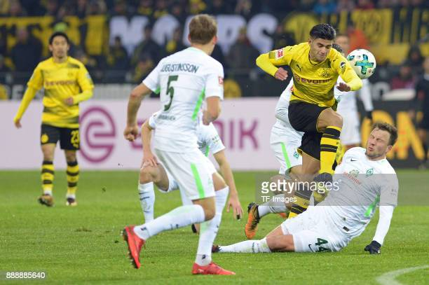 Mahmoud Dahoud of Dortmund and Philipp Bargfrede of Bremen battle for the ball during the Bundesliga match between Borussia Dortmund and SV Werder...