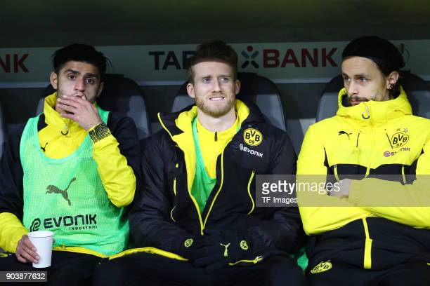 Mahmoud Dahoud of Dortmund Andre Schuerrle of Dortmund and Neven Subotic of Dortmund look on during the DFB Cup match between Bayern Muenchen and...