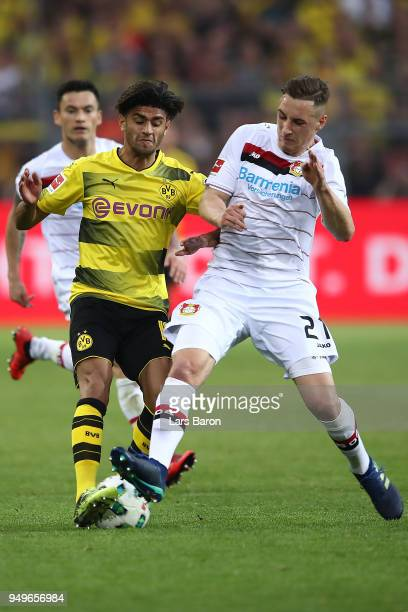 Mahmoud Dahoud of Dortmund fights for the ball with Dominik Kohr of Bayer Leverkusen during the Bundesliga match between Borussia Dortmund and Bayer...