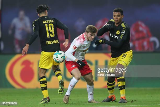 Mahmoud Dahoud of Dortmund Timo Werner of Leipzig and Manuel Akanji of Dortmund fight for the ball during the Bundesliga match between RB Leipzig and...