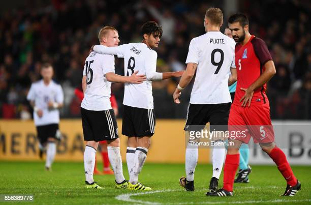 Mahmoud Dahoud of Germany celebrates with Philipp Ochs and Felix Platte during the UEFA Under21 Euro 2019 Qualifier match between U21 of Germany and...