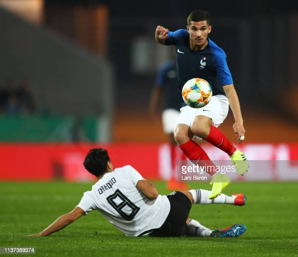 Mahmoud Dahoud of Germany challenges Houssem Aouar of France during the Germany U21 v France U21 International Friendly match on March 21 2019 in...