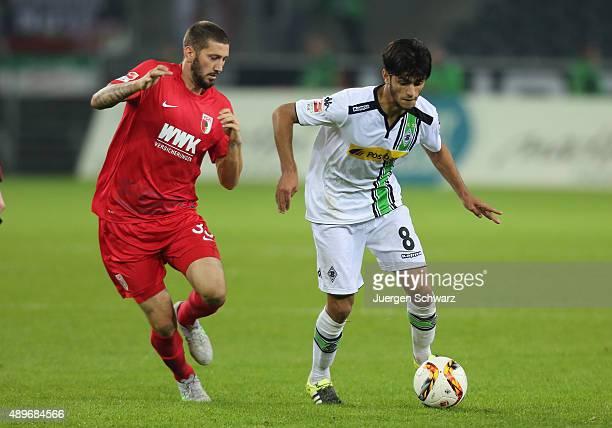 Mahmoud Dahoud of Moenchengladbach and Sascha Moelders of Augsburg fight for the ball during the Bundesliga match between Borussia Moenchengladbach...