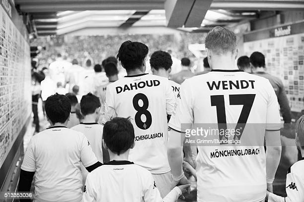 Mahmoud Dahoud of Moenchengladbach and team mates wait in the tunnel prior to the Bundesliga match between Borussia Moenchengladbach and VfB...