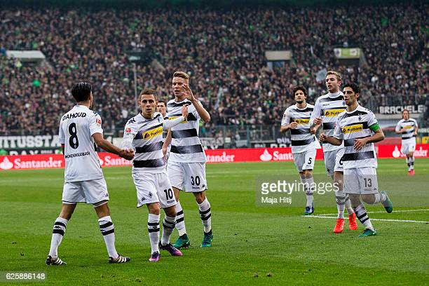 Mahmoud Dahoud of Moenchengladbach celebrates with teammates after scoring a goal to make it 10 during the Bundesliga match between Borussia...