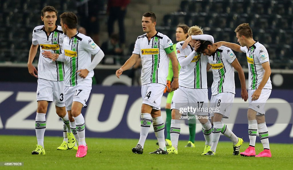 Mahmoud Dahoud of Moenchengladbach (2ndR) is hugged by Patrick Herrmann (R) and Oscar Wendt after scoring during the Bundesliga match between Borussia Moenchengladbach and FC Augsburg at Borussia-Park on September 23, 2015 in Moenchengladbach, Germany.