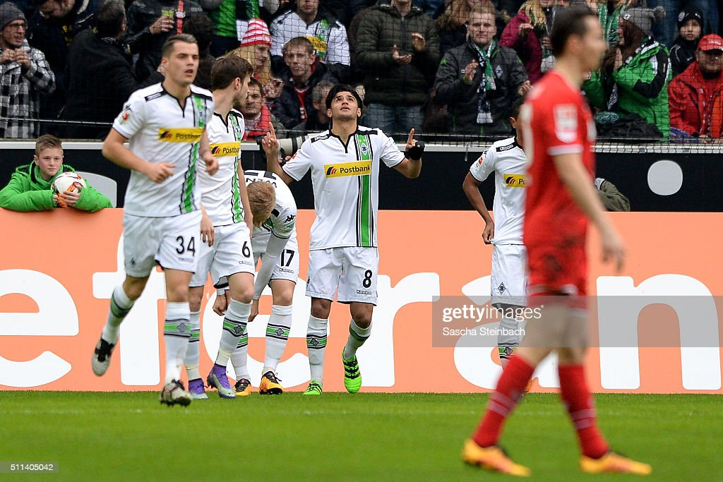 Mahmoud Dahoud (C) of Moenchengladbach reacts after scoring the opening goal during the Bundesliga match between Borussia Moenchengladbach and 1. FC Koeln at Borussia-Park on February 20, 2016 in Moenchengladbach, Germany.