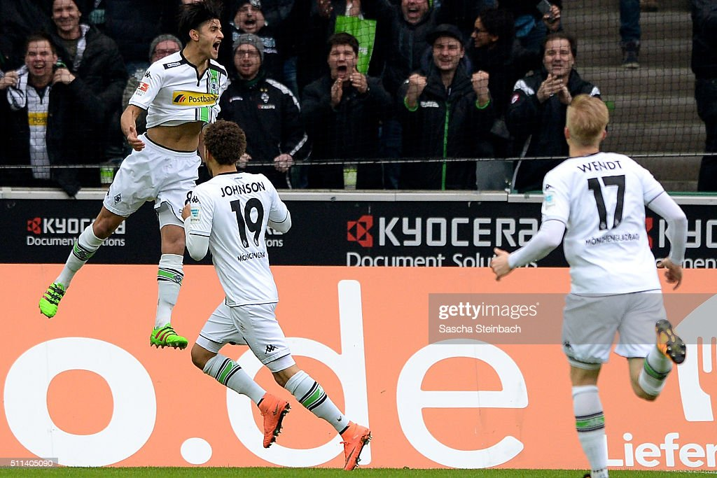 Mahmoud Dahoud (L) of Moenchengladbach reacts after scoring the opening goal during the Bundesliga match between Borussia Moenchengladbach and 1. FC Koeln at Borussia-Park on February 20, 2016 in Moenchengladbach, Germany.