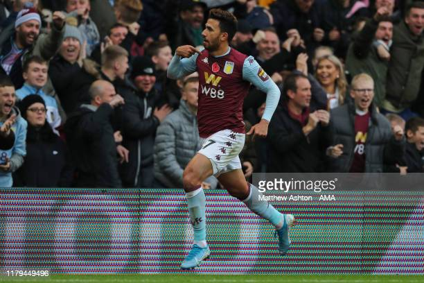 Mahmoud Hassan of Aston Villa celebrates after scoring a goal to make it 10 during the Premier League match between Aston Villa and Liverpool FC at...