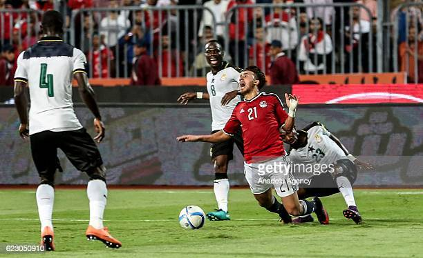 Mahmoud Hassan of Egypt in action against Harrison Afful of Ghana during the 2018 World Cup Africa qualifying match between Egypt and Ghana at the...