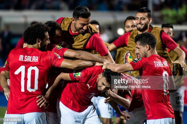 Mahmoud Hassan Trezeguet of Egypt celebrate with his team mates Ayman Ashraf Elsayed Mohamed Elneny Marwan Mohsen Fahmy Tarwat Mohamed Salah and...
