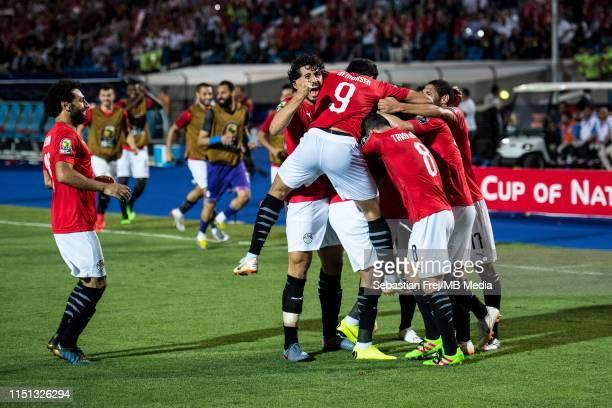 Mahmoud Hassan Trezeguet of Egypt celebrate with his team mates Ayman Ashraf Elsayed Mohamed Elneny Marwan Mohsen Fahmy Tarwat Mohamed Salah and...