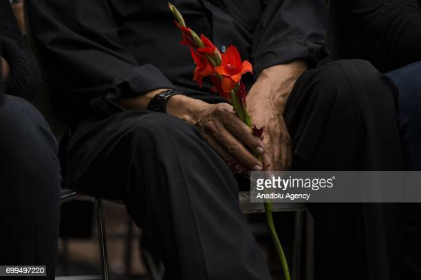 Mahmoud Hassanen holds flowers during the vigil at Lake Anne Plaza for his daughter Nabra Hassanen who was murdered Sunday on her way back to an...