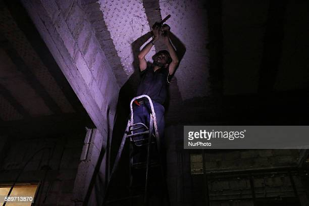 Mahmoud installs an alternative household electricity in his house in Douma on August 14 2016 After the cut of electricity by Syrian regime Mahmoud...