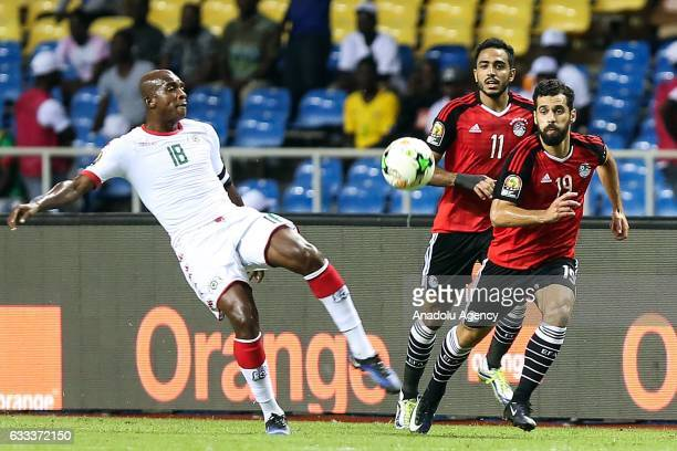Mahmoud Kahraba and Abdalla El Said of Egypt in action against Charles Kabore of Burkina Faso during the 2017 Africa Cup of Nations semifinal...