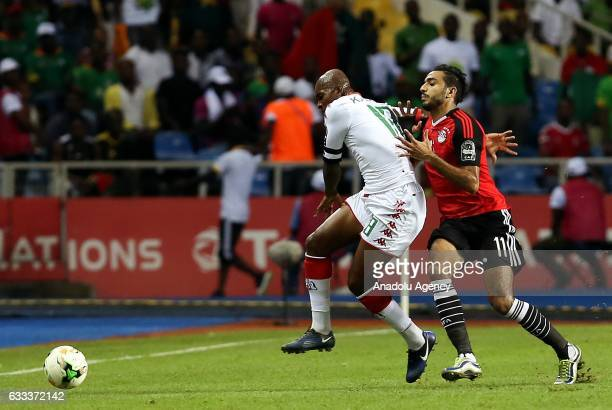 Mahmoud Kahraba of Egypt in action against Charles Kabore of Burkina Faso during the 2017 Africa Cup of Nations semifinal football match between...