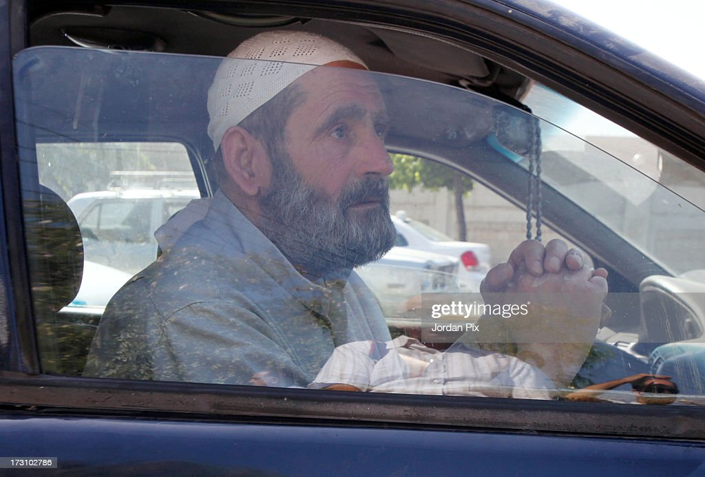 Mahmoud Othman Omar, the father of terror suspect Abu Qatada, departs after meeting with him in the Jordanian State Security Court on July 7, 2013 in Amman, Jordan. Hardline Islamist cleric Abu Qatada arrived in Jordan earlier today after being deported from the UK to face terrorism charges in his home country.