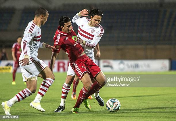 Mahmoud Trezeguet of AL Ahly vies for the ball with Hamada Tolba of Zamalek during a football match between Al Ahly and Zamalek during Egyptian...