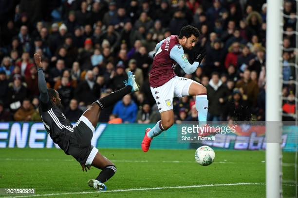 Mahmoud Trezeguet of Aston Villa shoots and scores his teams second goal during the Carabao Cup Semi Final match between Aston Villa and Leicester...