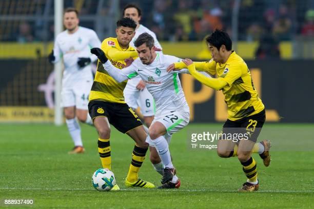 Mahmound Dahoud of Dortmund Fin Bartels of Bremen and Shinji Kagawa of Dortmund battle for the ball during the Bundesliga match between Borussia...