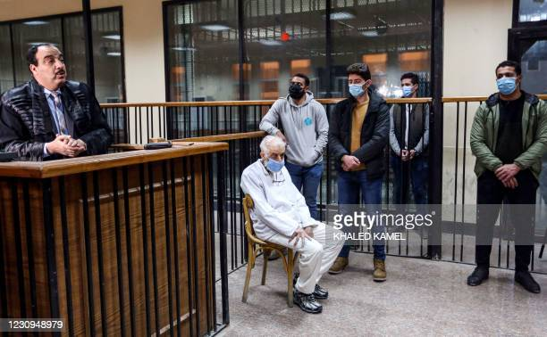 Mahmud Ezzat, acting leader of Egypt's Muslim Brotherhood society, sits mask-clad due to the COVID-19 coronavirus pandemic as he attends a trial...