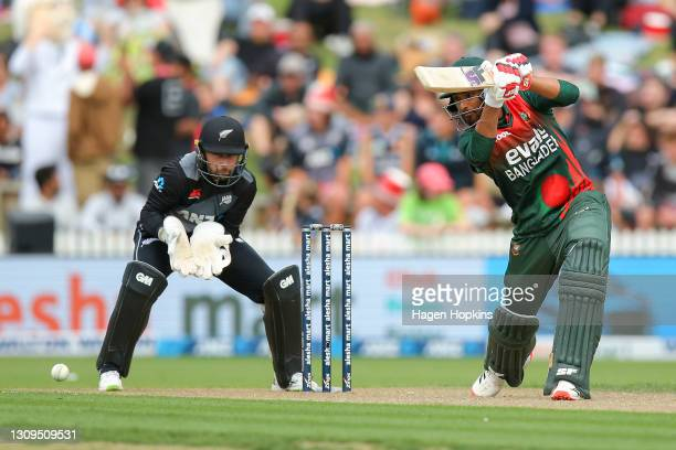 Mahmudullah of Bangladesh bats while Devon Conway of New Zealand looks on during game one of the International T20 series between New Zealand and...