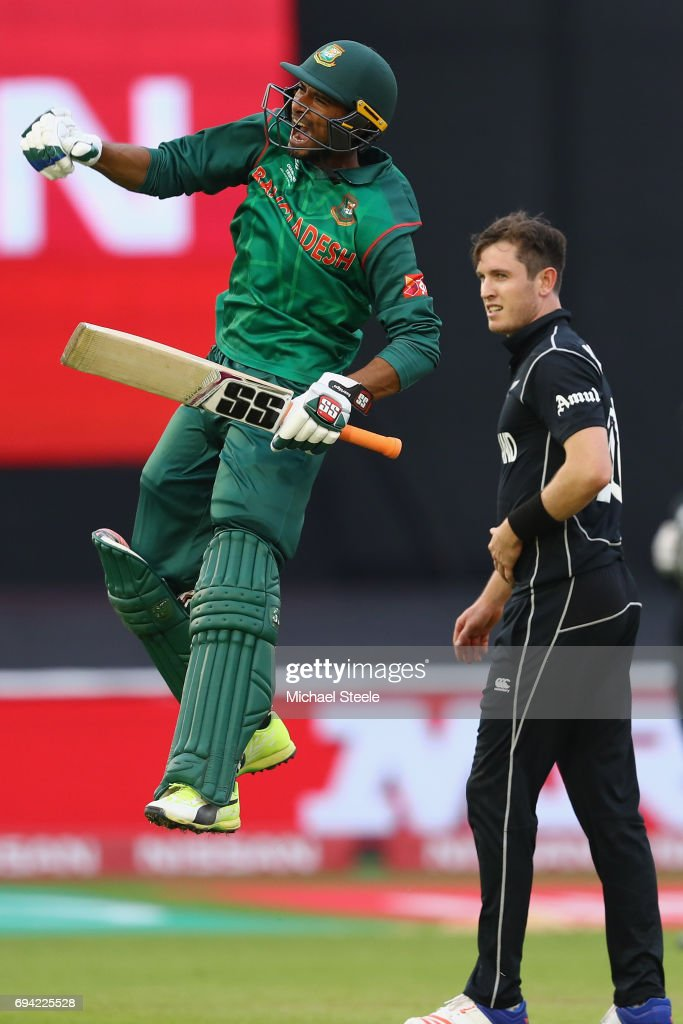 Mahmudullah of Bangladesh celebrates the winning runs as he finishes 102 not out to see his side win by 5 wickets as Adam Milne of New Zealand looks on during the ICC Champions Trophy match between New Zealand and Bangladesh at the SWALEC Stadium on June 9, 2017 in Cardiff, Wales.