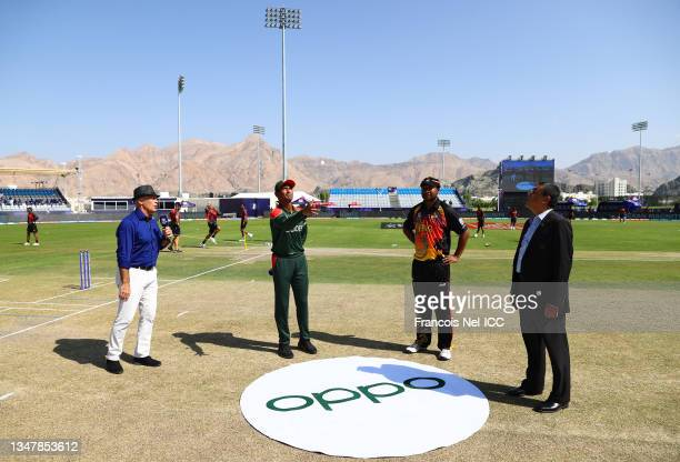 Mahmudullah of Bangladesh flips the coin as Assad Vala of Papua New Guinea looks on ahead of the ICC Men's T20 World Cup match between Bangladesh and...