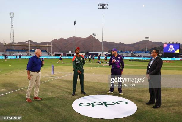Mahmudullah of Bangladesh flips the coin as Kyle Coetzer of Scotland looks on ahead of the ICC Men's T20 World Cup match between Bangladesh and...