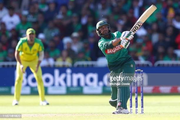 Mahmudullah of Bangladesh hits a six over long on off the bowling of Pat Cummins during the Group Stage match of the ICC Cricket World Cup 2019...