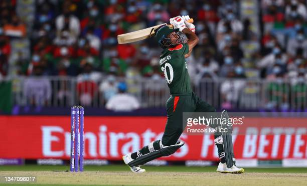 Mahmudullah of Bangladesh plays a shot during the ICC Men's T20 World Cup match between Bangladesh and Scotland at Oman Cricket Academy Ground on...