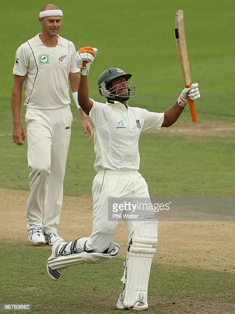 Mahmudullah Riyad of Bangladesh celebrates his century as Chris Martin of New Zealand looks on during day three of the First Test match between New...