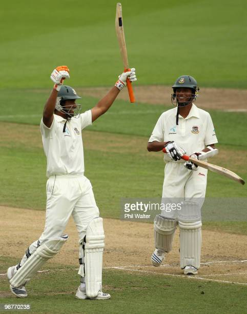 Mahmudullah Riyad of Bangladesh celebrates his century as Shafiul Islam looks on during day three of the First Test match between New Zealand and...