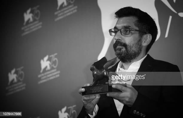 Image has been converted to black and white Mahmut Fazil Coskun poses with the Special Orizzonti Jury Prize for 'The Announcement ' at the Winners...