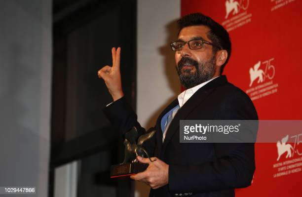 Mahmut Fazil Coskun poses with the Special Orizzonti Jury Prize for 'The Announcement ' at the Winners Photocall during the 75th Venice Film Festival...