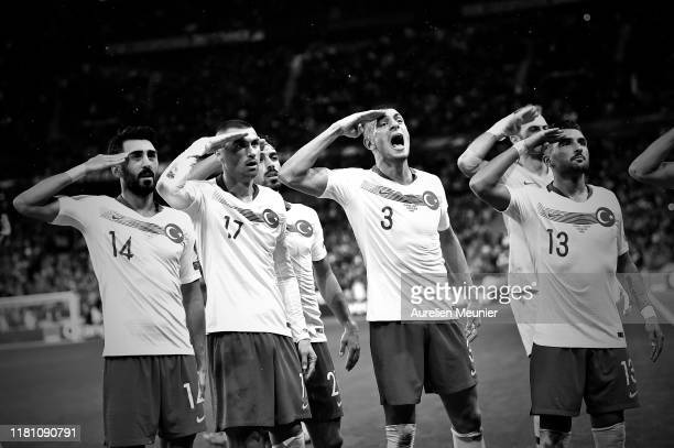 Mahmut Tekdemir Burak Yilmaz Merih Demiral and Umut Meras react by making a military salute after Kaan Ayhan goal during the UEFA Euro 2020 qualifier...
