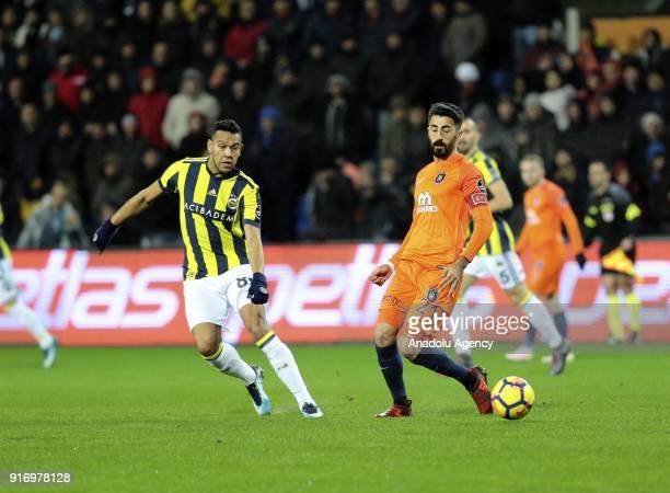 Mahmut Tekdemir of Medipol Basaksehir in action against Josef De Souza of Fenerbahce during the Turkish Super Lig soccer match between Medipol...