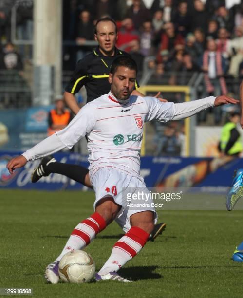 Mahmut Termuer of Regensburg scores his first goal during the third league match between Jahn Regensburg and 1. FC Heidenheim at Jahnstadion on...