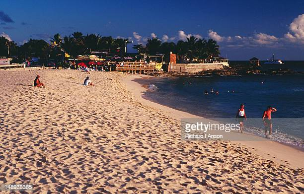 maho beach & sunset beach bar. - image title stock pictures, royalty-free photos & images