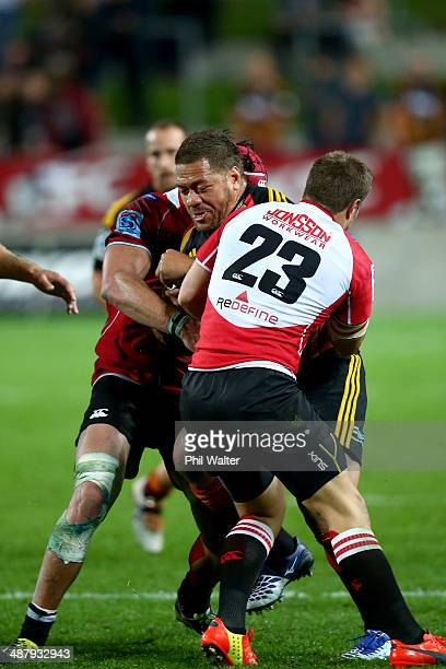 Mahonri Schwalger of the Chiefs is tackled by JW Jonker of the Lions during the round 12 Super Rugby match between the Chiefs and the Lions at...