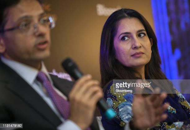 Mahreen Rahman chief executive officer of Alfalah GHP Investment Management Ltd right listens to Mohammed Sohail chief executive officer of Topline...