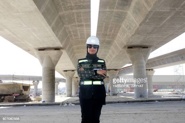 Mai Ibrahim AlMesad Project Manager of the maritime section of the Jaber AlAhmad Causeway poses for a picture at the construction site in Kuwait City...