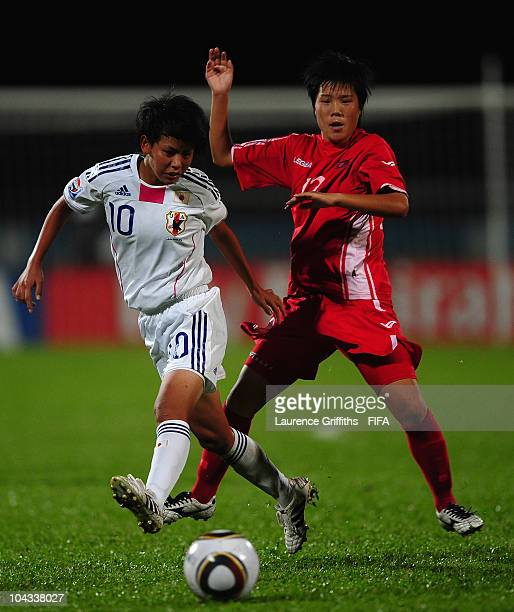Mai Kyokawa of Japan battles with Choe Jong Hwa of North Korea during the FIFA U17 Women's World Cup Semi Final match between North Korea and Japan...