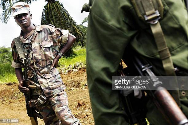 Mai Mai fighters stand outside the Walikale Administrative office in Democratic Republic of Congo 09 December 2004 Over the past months the city of...