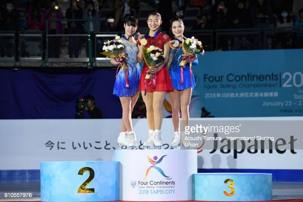 Mai Mihara Kaori Sakamoto and Satoko Miyahara of Japan pose with on the podium during day three of the Four Continents Figure Skating Championships...